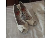 Wedding dress for sale and shoes size 5 ivory in colour short train at back of dress