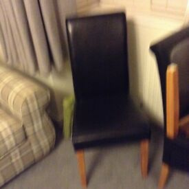 Six black dining chairs for sale