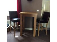 Solid oak tall dining table and leather chairs