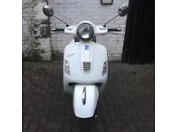 Vespa GTS 125 Super IE 2011 in top class condition very low mileage 2000 miles only Gilera