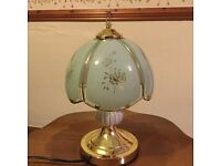 Touch lamp in ornate glass panels