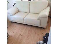 Excellent condition, 2 seater, cream leather sofa