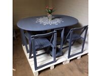 Grey dining table with four chairs, unique mandala design, fold away, collapsible