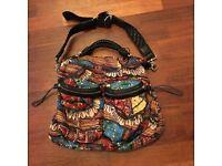 Designer L.A.M.B. Cowry shell print handbag: UNUSED