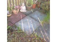 3 grey paving slabs