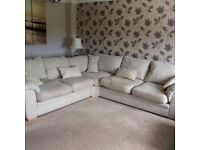 Beige fabric 6 seater corner sofa with foot stool and corner foot stool. Excellent condition