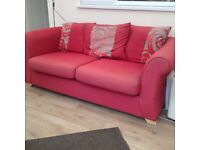 Free large red sofa in good used condition