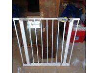 White adjustable stair gate