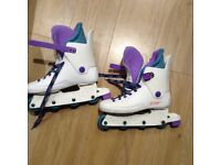Ladies inline skates size 5-8, hardly used. White with purple and turquoise trim.