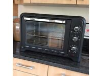 Portable Moulinex Oven Model OX484811 perfect for camping if electrical hook up available or bedsit.