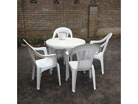 Plastic table and 4 chairs for garden