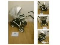 SALE MASSIVE STOCK CLEARANCE MUST GO stunning white lux reversible pram