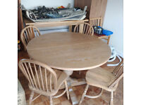 Extending Round Dining table with 4 chairs, solid oak, carved leg. Jaycee Furniture
