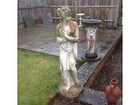 A pair of garden statues