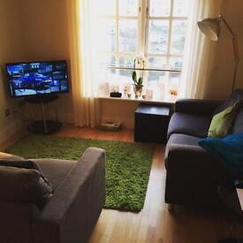 2 grey fabric 2 seater sofas