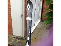 Grey skis with poles.