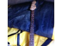 Fender squire bass guitar neck.