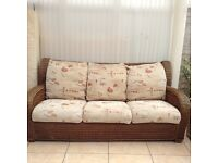 Three Seater Rattan Sofa with removable cushion covers