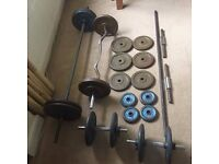 150kg mix of weight plates, bars, dumbells and multigym bench - A bargain at £100