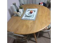 Ercol drop leaf dining table round....sanded and waxed..blonde finish