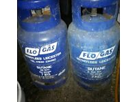 two empty 7kg gas bottles