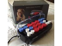 BABYLISS heated roller set . Previously loved,full set .good working orders .2 heat control.