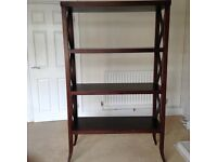 Dark wood display unit with leather inlaid shelves.