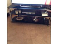 Large smoked glass and chrome Tv stand