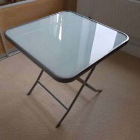 Folding table, glass topped