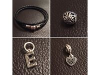 Genuine Pandora black leather bracelet and charms