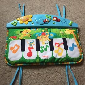 Fisher price rainforest kick n play piano cot rail toy