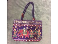 Hand bags : approx 14 inc long , 3 inc wide and 10 inc deep . 7 bags in 6 different designs.