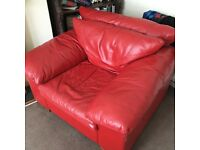 Red leather armchair and poof