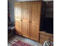 Two Ikea wooden wardrobes