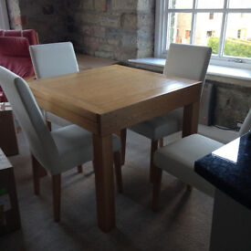 Solid Oak Dining table and 4 upholstered chairs