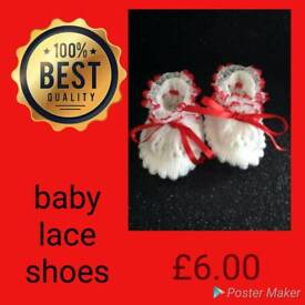 Babies lace shoes