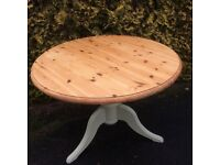 Round pedestal pine table
