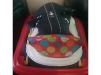 Baby bjorn baby carrier and a baby walker by baby zoo