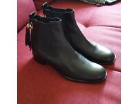 Russell and Bromley size 41 chelsea boots with tassels. Never worn, only tried on.
