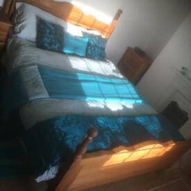 Pine double bed includes mattress pillows throws etc