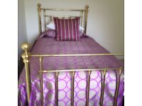 Two brass 3 foot 6 inch beds
