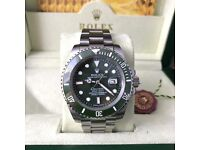 Silver with green face & bezel. Submariner Rolex. Complete with Box, Bag & Paperwork.