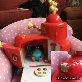 Various toddler toys and chair