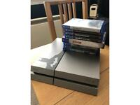 PlayStation 4 games and two controllers