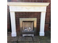 Pebble coal effect gas fire with mantel surround