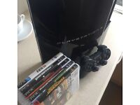 PS3 80gb with controller + 5 games