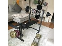 Bench Press and 42kg of weights & also curl bar.