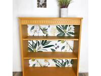Mustard yellow botanical decoupaged bookcase