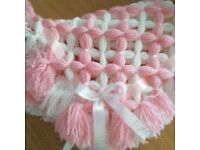 Beautiful handmade baby Pom Pom blankets. Can be made in any colour or design.