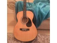 Acoustic Martinsmiths guitar with carry case and music book